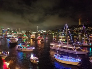 Parade of decorated boats in holiday formation