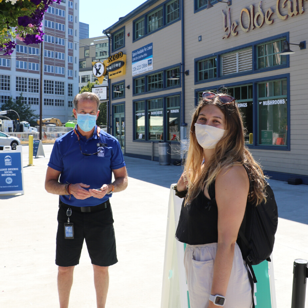 Argosy Cruises employee with a guest wearing mask